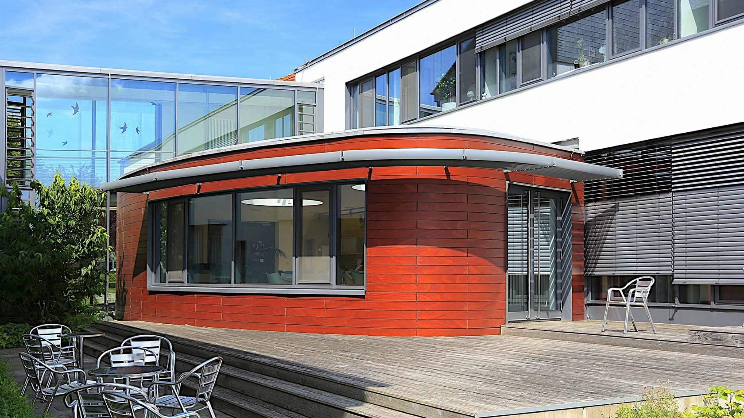 Zimmererarbeiten Gebäudeteil Rund mit Terrasse